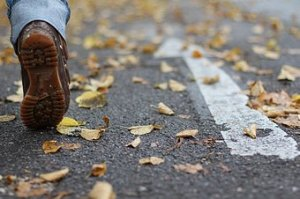 253330-stock-photo-human-being-leaf-street-autumn-feet-walking