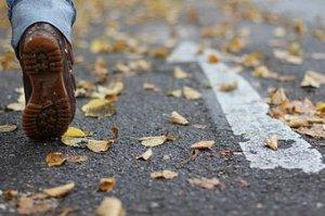 253330-stock-photo-human-being-leaf-street-autumn-feet-walking